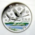 洞爺湖とタンチョウを図案化した1000円貨幣